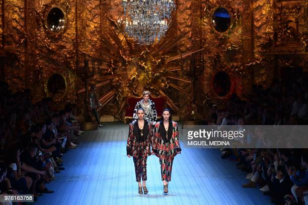 Models present creations by Dolce Gabbana during the men women's spring/summer 2019 collection fashion show in Milan on June 16 2018