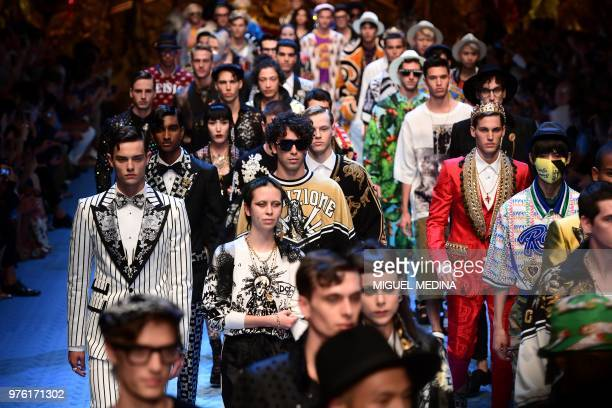 Models present creations by Dolce Gabbana during the men's women spring/summer 2019 collection fashion show in Milan on June 16 2018