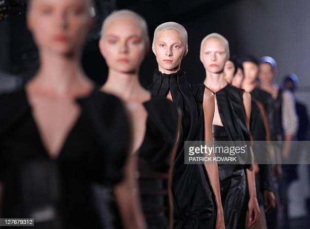 Models present creations by Dutch designer Josephus Thimister during the Spring/Summer 2012 readytowear collection show on September 27 2011 in Paris...