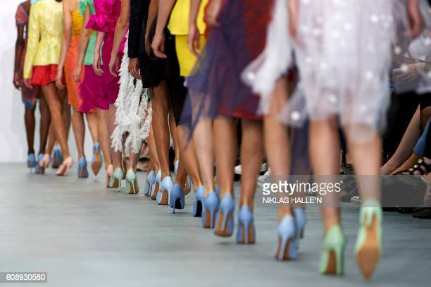 Models present creations by Emilio de la Morena during his 2017 Spring / Summer catwalk show at London Fashion Week in London on September 20 2016 /...