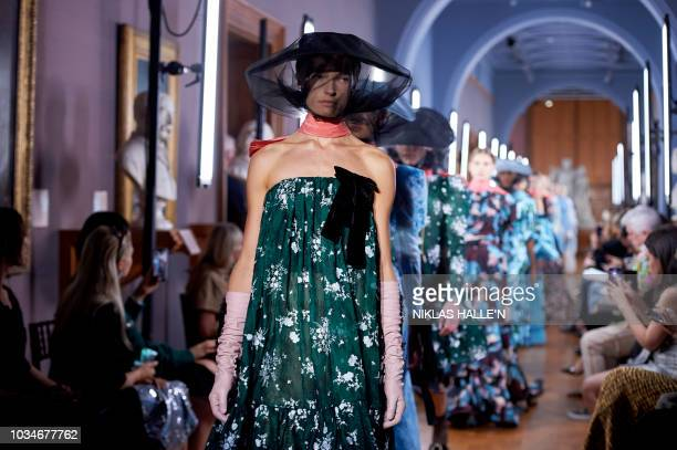 Models present creations by Erdem, during a catwalk show for the Spring/Summer 2019 collection on the fourth day of London Fashion Week in London on...