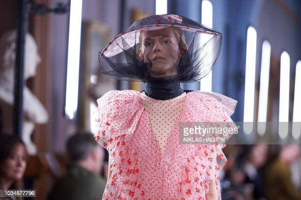 Models present creations by Erdem during a catwalk show for the Spring/Summer 2019 collection on the fourth day of London Fashion Week in London on...