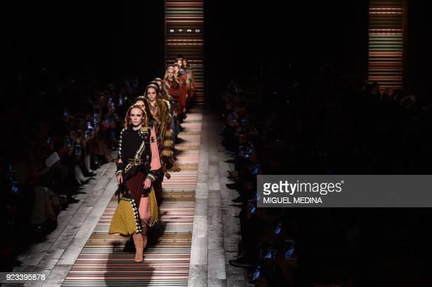 TOPSHOT Models present creations by Etro during the women's Fall/Winter 2018/2019 collection fashion show in Milan on February 23 2018