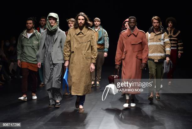 TOPSHOT Models present creations by fashion brand Theatre Products for their 2018 autumn/winter collection at Tokyo Fashion Week in Tokyo on March 23...