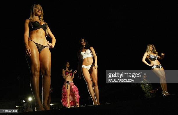 Models present creations by fashion designer Adriana Arango Colombia's brand Besame at the fourth brigade of Colombian Army on June 13 2008 in...