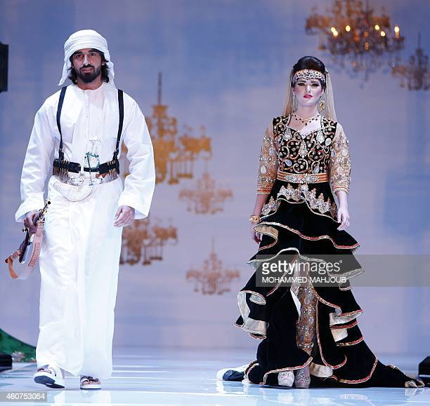 Models present creations by fashion designers Mohammed alSobhi and Amal alBalushi during the Gulf's Forum of Elegance event on December 21 2014 in...