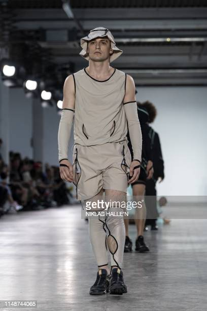 Models present creations by fashion house Fashion East on the second day of the Spring/Summer 2020 London Fashion Week Men's fashion event in London...