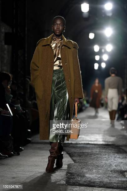 Models present creations by fashion house Rejina Pyo during the catwalk show for their Autumn/Winter 2020 collection on the second day of London...