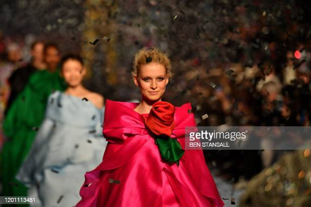 Models present creations by fashion house Richard Quinn during the catwalk show for their Autumn/Winter 2020 collection on the second day of London...