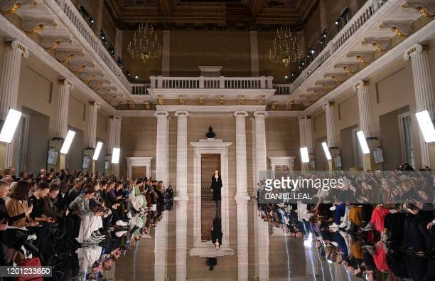 Models present creations by fashion house Victoria Beckham during her catwalk show for their Autumn/Winter 2020 collection on the third day of London...