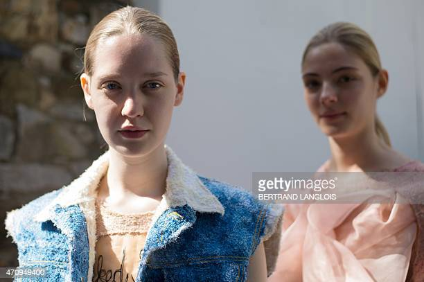 Models present creations by Finnish designer Elina Määttänen during the 30th edition of the International Festival of Fashion and Photography on...