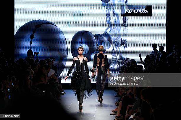 Models present creations by French designer Julien Fournie during the Fall/Winter 20112012 Haute Couture Collection Show on July 5 2011 in Paris AFP...