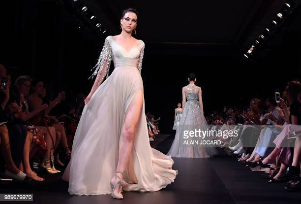 Models present creations by Georges Hobeika during the 20182019 Fall/Winter Haute Couture collection fashion show in Paris on July 2 2018