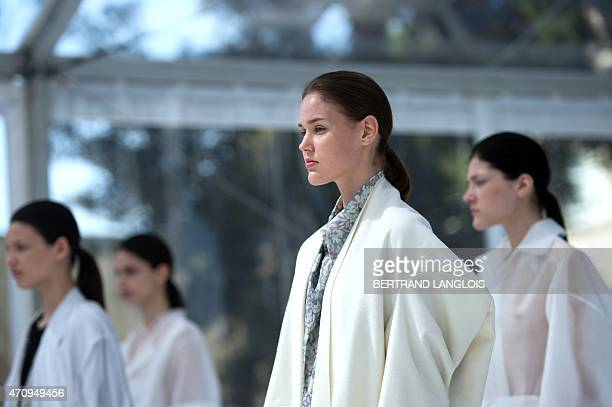 Models present creations by German designer Christina Braun during the 30th edition of the International Festival of Fashion and Photography on April...