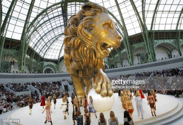 Models present creations by German designer Karl Lagerfeld for Chanel during the FallWinter 2010/2011 Haute Couture Collection Show on July 6 at the...