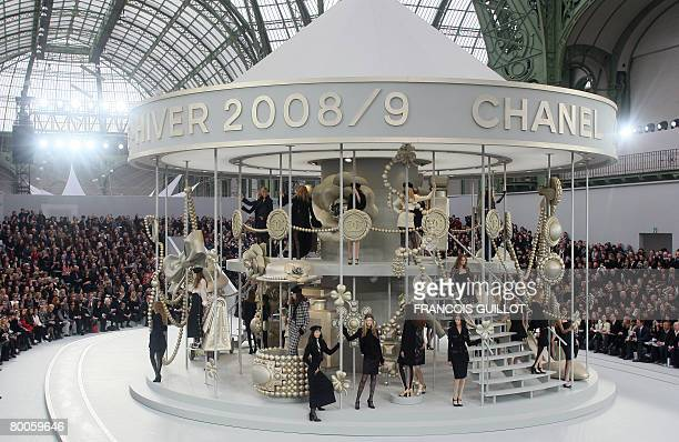 Models present creations by German designer Karl Lagerfeld for Chanel during the autumn/winter 20082009 readytowear collection show in Paris 29...