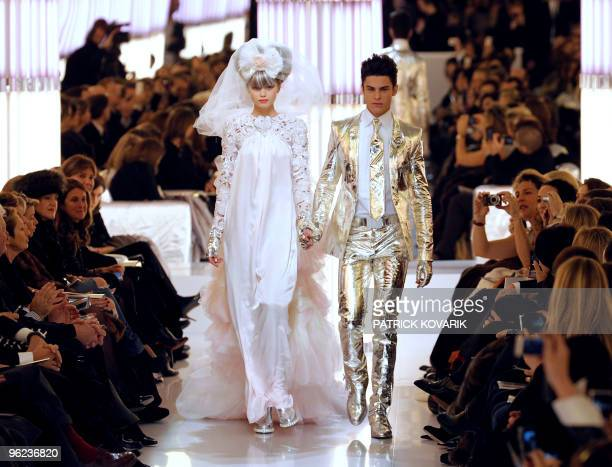 Models present creations by German designer Karl Lagerfeld for Chanel during the springsummer 2010 haute couture collection show on January 26 2010...