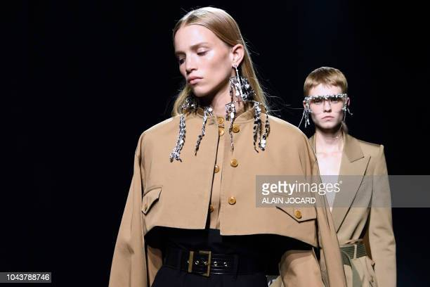 Models present creations by Givenchy during the Spring-Summer 2019 Ready-to-Wear collection fashion show in Paris, on September 30, 2018.