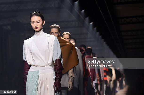 Models present creations by Givenchy during the Women's Fall-Winter 2020-2021 Ready-to-Wear collection fashion show at the ParisLongchamp Racecourse...