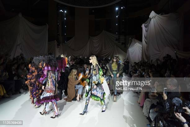 Models present creations by Greek designer Mary Katranzou during her 2019 Autumn / Winter collection catwalk show at London Fashion Week in London on...