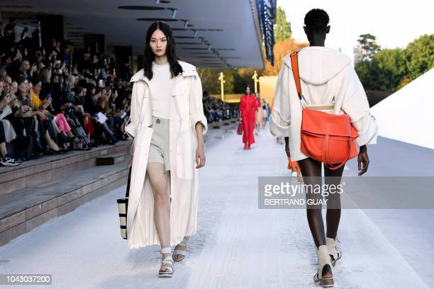Models present creations by Hermes during the SpringSummer 2019 ReadytoWear collection fashion show in Paris on September 29 2018