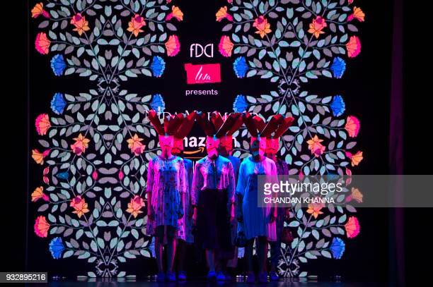 Models present creations by Indian designer Nida Mahmood during the Amazon India Fashion Week Autumn Winter 2018 in New Delhi on March 16 2018 / AFP...