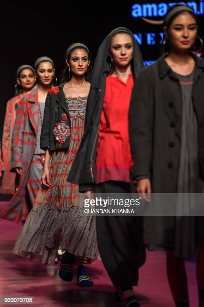 Models present creations by Indian fashion designer Aneeth Arora during the Amazon India Fashion Week Autumn/Winter 2018 in New Delhi on March 17...