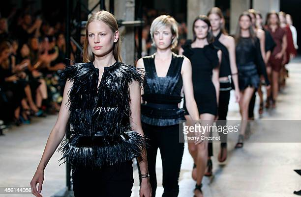 Models present creations by Isabel Marant during the 2015 Spring/Summer readytowear collection fashion show on September 26 2014 in Paris France