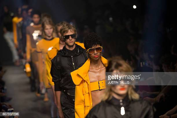 Models present creations by Italian designer Versace's Versus label during the 2017 Spring / Summer catwalk show at London Fashion Week in London on...