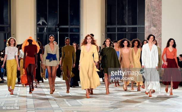 TOPSHOT Models present creations by Jacquemus during the Fall/Winter 20182019 fashion week on February 26 in Paris / AFP PHOTO / ALAIN JOCARD