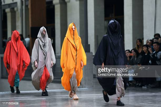 TOPSHOT Models present creations by Japanese designer Issey Miyake during the Women's SpringSummer 2020 ReadytoWear collection fashion show in Paris...