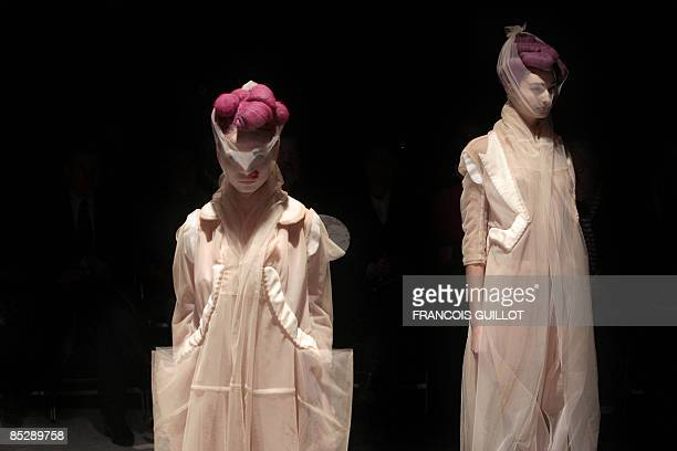 Models present creations by Japanese designer Rei Kawakubo for Comme des Garcons during the autumn/winter 2009 readytowear collection show in Paris...