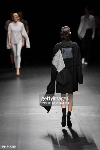 Models present creations by Japanese fashion brand DressedUndressed from their 2018 autumn/winter collection at the Tokyo Fashion Week in Tokyo on...