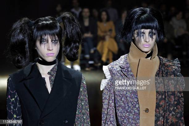 Models present creations by Junya Watanabe during the Fall-Winter 2019/2020 Ready-to-Wear collection fashion show in Paris, on March 2, 2019.