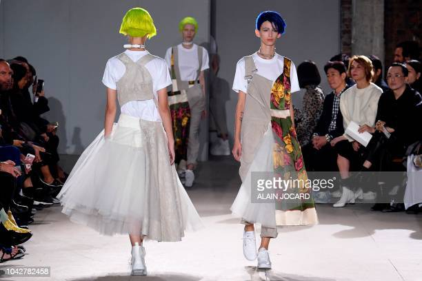 Models present creations by Junya Watanabe during the Spring-Summer 2019 Ready-to-Wear collection fashion show in Paris, on September 29, 2018.