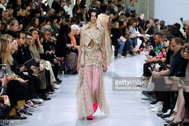 Models present creations by Junya Watanabe during the Women's Spring-Summer 2020 Ready-to-Wear collection fashion show, in Paris on September 28,...