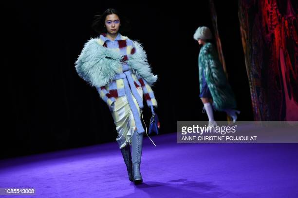 Models present creations by Kenzo during the men's Fall/Winter 2019/2020 collection fashion show in Paris on January 20 2019