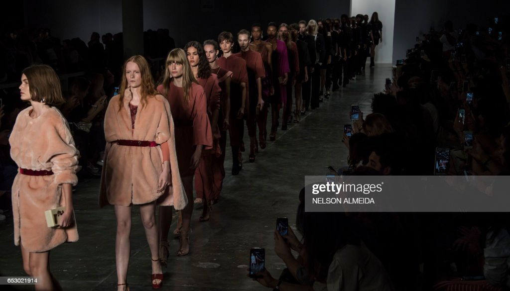 Models present creations by Lilly Sarti during the Sao Paulo Fashion Week in Sao Paulo, Brazil on March 13, 2017. /