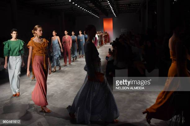 TOPSHOT Models present creations by Lilly Sarti during the Sao Paulo Fashion Week in Sao Paulo Brazil on April 23 2018