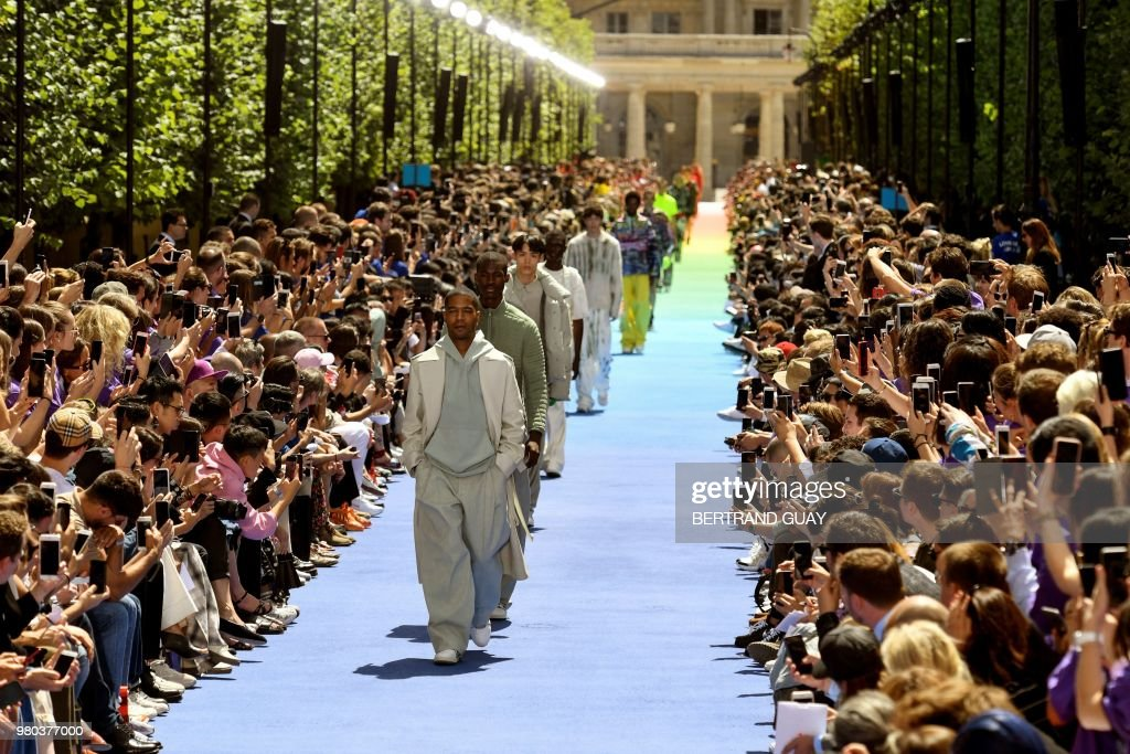 TOPSHOT - Models present creations by Louis Vuitton at the end of the men's Spring/Summer 2019 collection fashion show on June 21, 2018 in Paris.