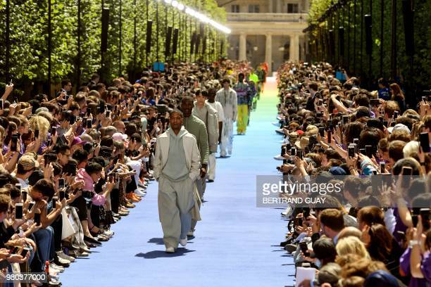 TOPSHOT Models present creations by Louis Vuitton at the end of the men's Spring/Summer 2019 collection fashion show on June 21 2018 in Paris