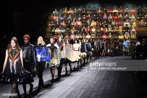 Models present creations by Louis Vuitton at the end of the Women's Fall-Winter 2020-2021 Ready-to-Wear collection fashion show in Paris, on March 3,...