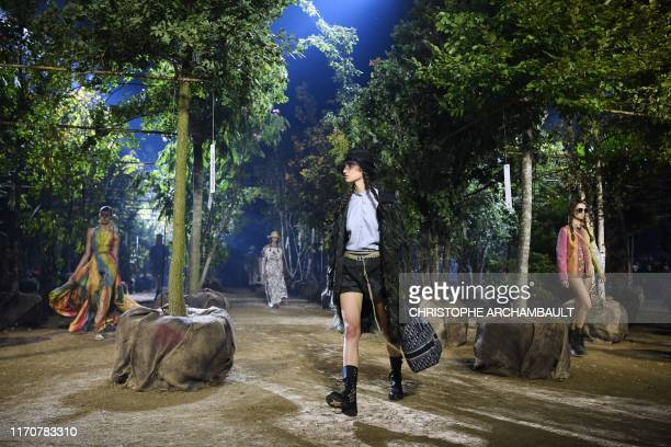 Models present creations by Maison Dior during the Women's Spring-Summer 2020 Ready-to-Wear collection fashion show at the Hippodrome de Longchamps...