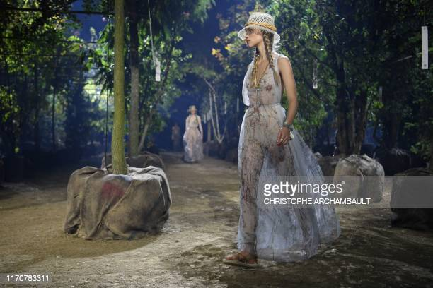 TOPSHOT Models present creations by Maison Dior during the Women's SpringSummer 2020 ReadytoWear collection fashion show at the Hippodrome de...