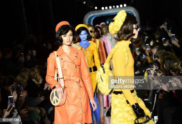 TOPSHOT Models present creations by Moschino during the women's Fall/Winter 2018/2019 collection fashion show in Milan on February 21 2018