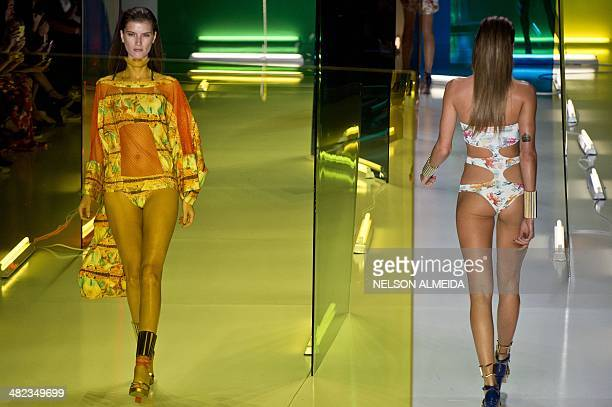 Models present creations by Movimento during the 2015 Summer collections of the Sao Paulo Fashion Week in Sao Paulo, Brazil, on April 3, 2014. AFP...