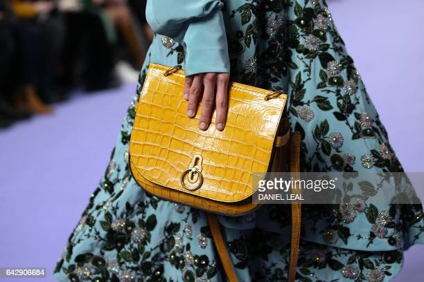 Models present creations by Mulberry during their catwalk show on the third day of the Autumn/Winter 2017 London Fashion Week at the Old Billingsgate...