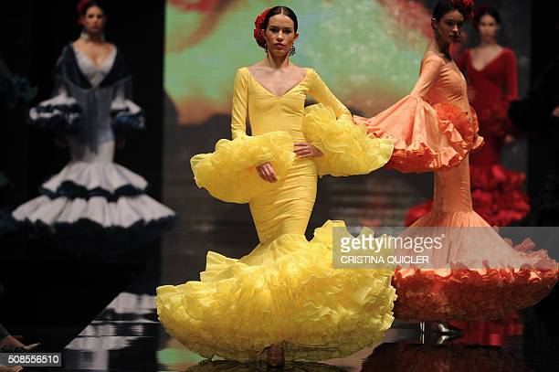 Models present creations by new designer Alejandro Santizo during the SIMOF in Sevilla on February 5 2016 AFP PHOTO/ CRISTINA QUICLER / AFP /...