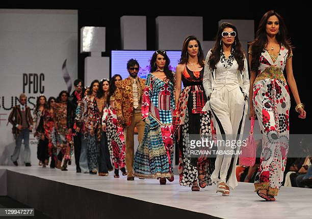 Models present creations by Pakistani designer Ammar Belal during the PFDC Sunsilk Fashion Week in Karachi on October 22 2011 AFP PHOTO/ RIZWAN...