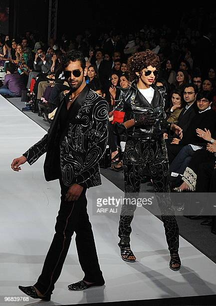 Models present creations by Pakistani designer Ammar Belal on the third day of Pakistan Fashion Design Council Fashion Week in Lahore on February 18...